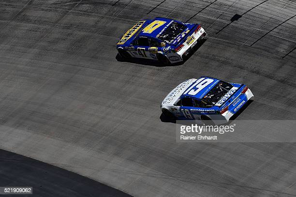 Allmendinger driver of the Bush's Beans Chevrolet races Carl Edwards driver of the Comcast Business Toyota during the NASCAR Sprint Cup Series Food...