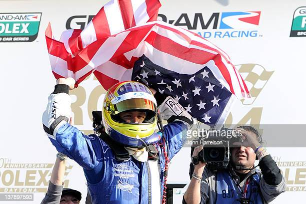 Allmendinger driver of the DP Michael Shank Racing Ford Riley celebrates in Victory Lane after winning the Rolex 24 at Daytona International Speedway...