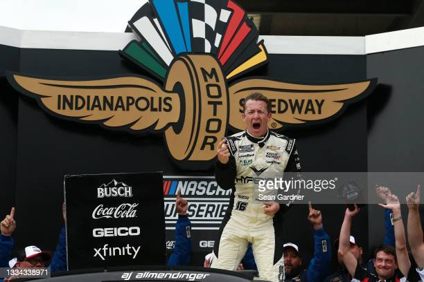 Allmendinger, driver of the Hyperice Chevrolet, celebrates in victory lane after winning the NASCAR Cup Series Verizon 200 at the Brickyard at...