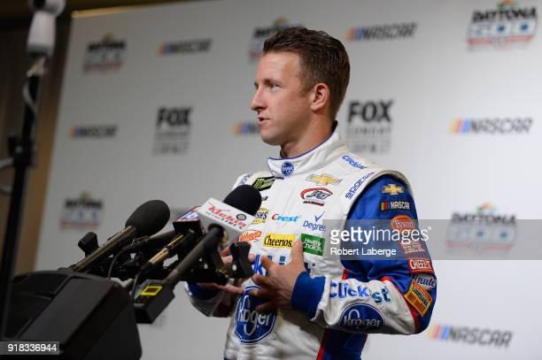 Allmendinger driver of the Kroger ClickList Chevrolet talks to the media during the Daytona 500 Media Day at Daytona International Speedway on...