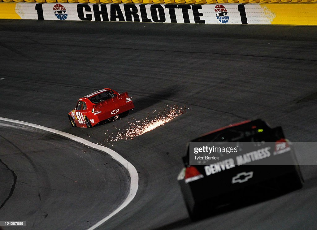 AJ Allmendinger, driver of the #51 Phoenix Construction Chevrolet, leads Kurt Busch, driver of the #78 Furniture Row/Farm American Chevrolet, during the NASCAR Sprint Cup Series Bank of America 500 at Charlotte Motor Speedway in Concord, North Carolina.