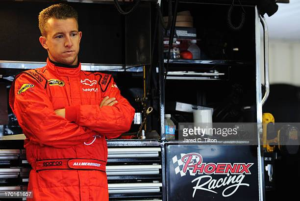 Allmendinger driver of the Phoenix Construction Services Chevrolet stands in the garage area during practice for the NASCAR Sprint Cup Series Party...