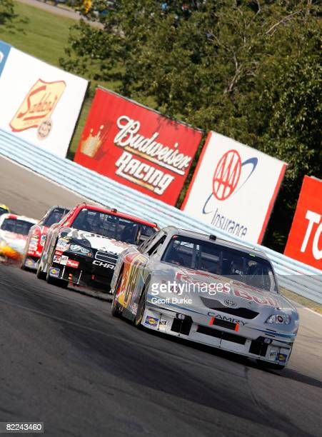 J Allmendinger driver of the Red Bull Toyota leads Robby Gordon driver of the Jim Beam Dodge during the NASCAR Sprint Cup Series Centurion Boats at...