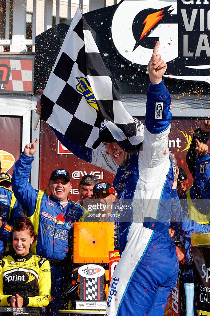 AJ Allmendinger, driver of the #47 Scott Products Chevrolet, celebrates in Victory Lane after winning the NASCAR Sprint Cup Series Cheez-It 355 at Watkins Glen International on August 10, 2014 in Watkins Glen, New York.