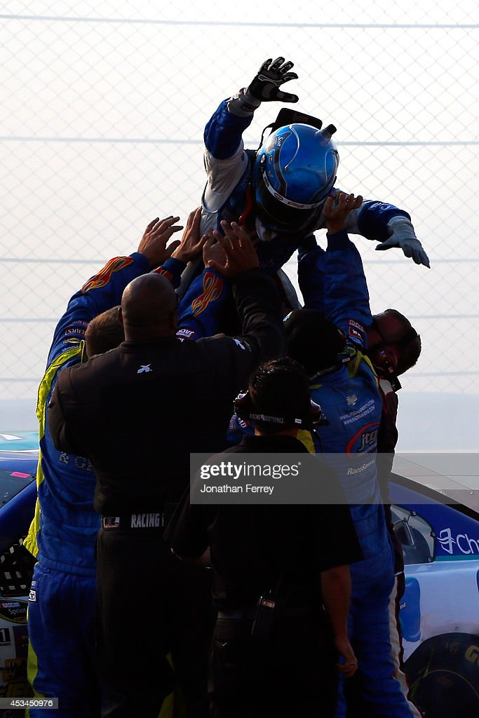 AJ Allmendinger, driver of the #47 Scott Products Chevrolet, celebrates with his crew after winning the NASCAR Sprint Cup Series Cheez-It 355 at Watkins Glen International on August 10, 2014 in Watkins Glen, New York.