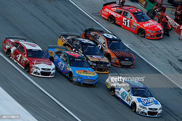 Allmendinger driver of the Scott Products Chevrolet Kevin Harvick driver of the Budweiser Chevrolet Aric Almirola driver of the Eckrich Ford Tony...