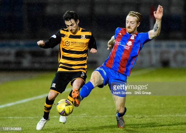 Alloa's Scott Taggart competes with David Carson during the Scottish Championship match between Inverness and Alloa at Tulloch Caledonian Stadium, on...