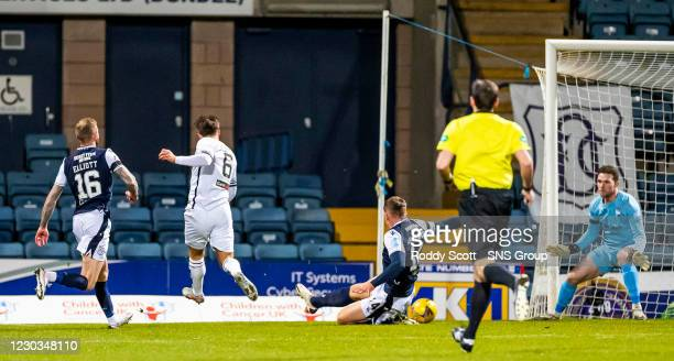 Alloa's Steven Hetherington makes it 1-0 early in the first half during the Scottish Championship match between Dundee and Alloa at Dens Park, on...