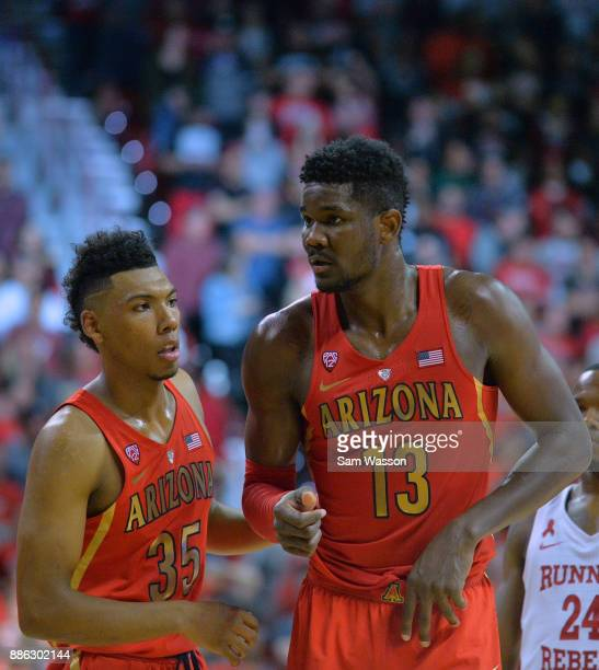 Allonzo Trier and Deandre Ayton of the Arizona Wildcats stand on the court during their game against the UNLV Rebels at the Thomas Mack Center on...