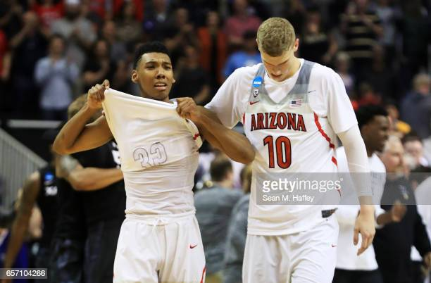 Allonzo Trier and Lauri Markkanen of the Arizona Wildcats react to their 71 to 73 loss ot the Xavier Musketeers during the 2017 NCAA Men's Basketball...