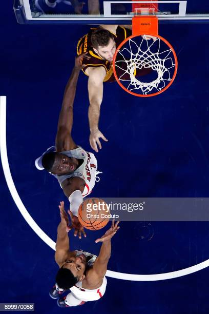 Allonzo Trier and Rawle Alkins of the Arizona Wildcats grab a rebound over Mickey Mitchell of the Arizona State Sun Devils during the second half of...