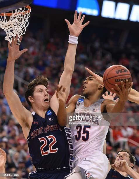 Allonzo Trier of the Arizona Wildcats attempts a layup defended by Dane Pineau of the St Mary's Gaels during the second round of the 2017 NCAA Men's...