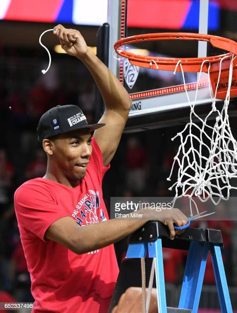 Allonzo Trier of the Arizona Wildcats cuts down a piece of a net after defeating the Oregon Ducks 8380 to win the championship game of the Pac12...