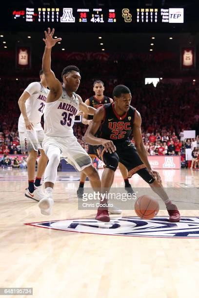 Allonzo Trier of the Arizona Wildcats defends De'Anthony Melton of the USC Trojans during the first half of the college basketball game at McKale...