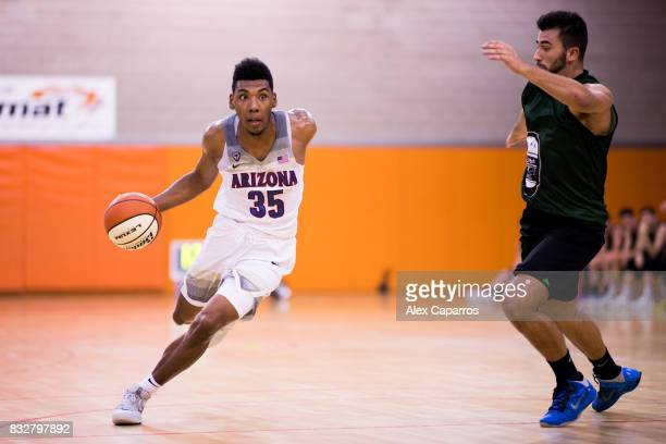 Allonzo Trier of the Arizona Wildcats dribbles Alfons Oleart of the Mataro AllStars during the Arizona In Espana Foreign Tour game between Mataro...