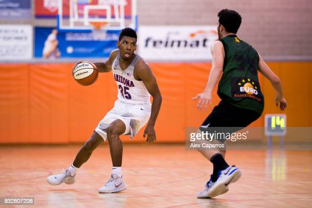 Allonzo Trier of the Arizona Wildcats dribbles Sergi Costa of the Mataro AllStars during the Arizona In Espana Foreign Tour game between Mataro...