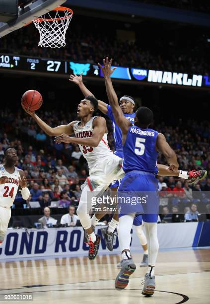 Allonzo Trier of the Arizona Wildcats drives to the basket against CJ Massinburg and Wes Clark of the Buffalo Bulls in the first half during the...