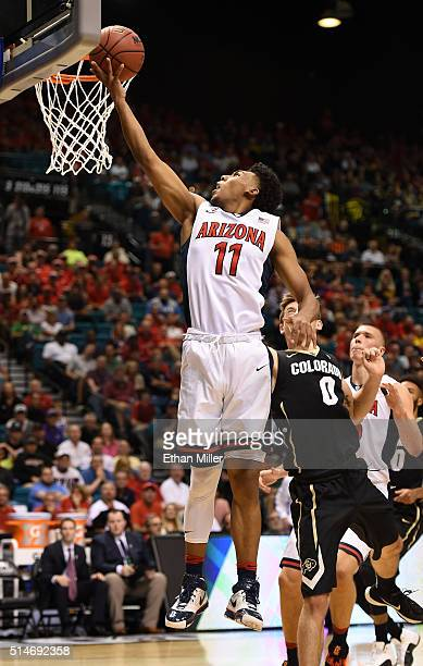 Allonzo Trier of the Arizona Wildcats drives to the basket against Thomas Akyazili of the Colorado Buffaloes during a quarterfinal game of the Pac12...