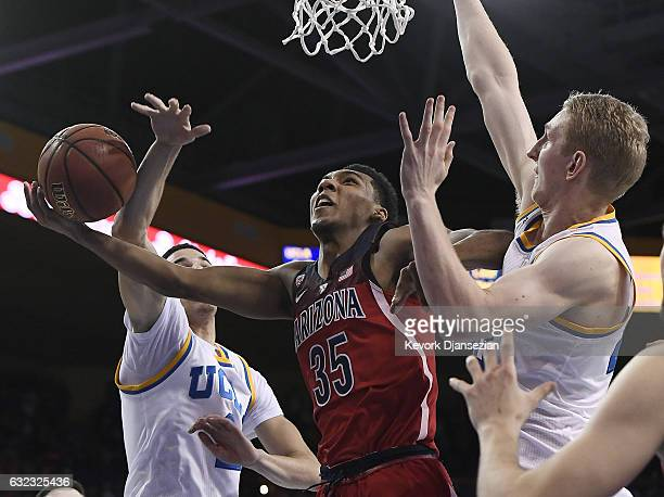 Allonzo Trier of the Arizona Wildcats drives to the basket against Lonzo Ball and Thomas Welsh of the UCLA Bruins during the second half of the...