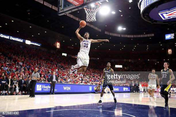 Allonzo Trier of the Arizona Wildcats dunks during the first half of the college basketball game against the Northern Arizona Lumberjacks at McKale...