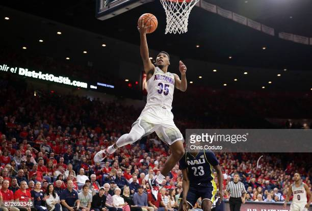 Allonzo Trier of the Arizona Wildcats dunks during the second half of the college basketball game against the Northern Arizona Lumberjacks at McKale...