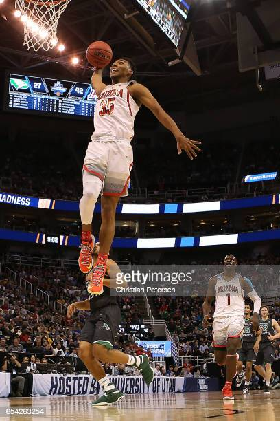Allonzo Trier of the Arizona Wildcats dunks the ball against the North Dakota Fighting Sioux during the first round of the 2017 NCAA Men's Basketball...