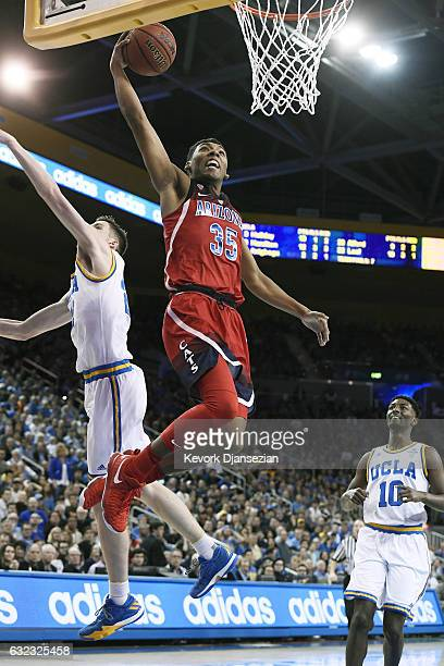 Allonzo Trier of the Arizona Wildcats elevates for a slam dunk against TJ Leaf of the UCLA Bruins during the second half of the college basketball...