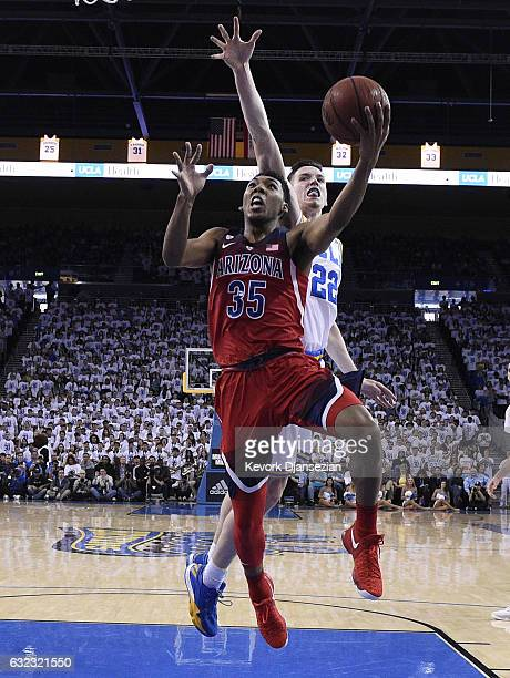 Allonzo Trier of the Arizona Wildcats goes up for a layup against TJ Leaf of the UCLA Bruins during the first half of the game at Pauley Pavilion on...
