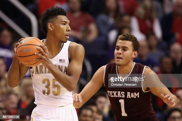Allonzo Trier of the Arizona Wildcats handles the ball against DJ Hogg of the Texas AM Aggies during the first half of the college basketball game at...