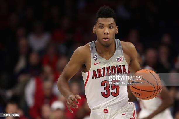 Allonzo Trier of the Arizona Wildcats handles the ball during the first half of the college basketball game against the Connecticut Huskies at McKale...