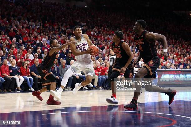 Allonzo Trier of the Arizona Wildcats is defended by De'Anthony Melton of the USC Trojans during the second half of the college basketball game at...