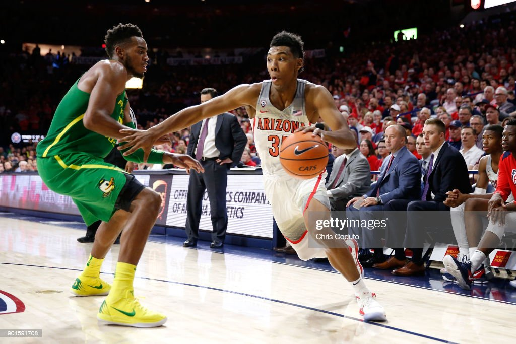 Allonzo Trier #35 of the Arizona Wildcats is defended by Troy Brown #0 of the Oregon Ducks during the second half of the college basketball game at McKale Center on January 13, 2018 in Tucson, Arizona. The Wildcats beat the Ducks 90-83.