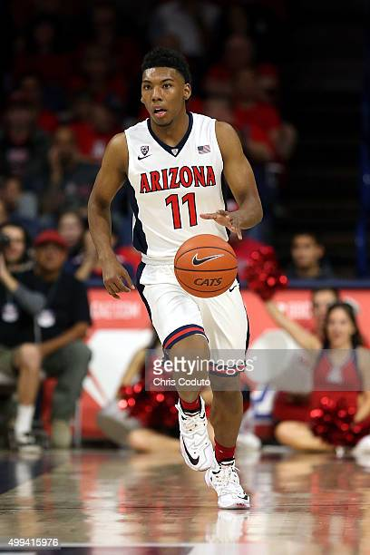 Allonzo Trier of the Arizona Wildcats runs up the floor during the first half of the college basketball game against the Pacific Tigers at McKale...