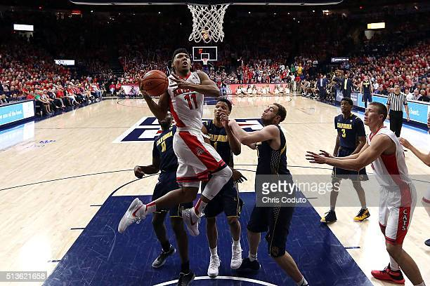 Allonzo Trier of the Arizona Wildcats shoots over Kameron Rooks of the California Golden Bears during the second half of the college basketball game...