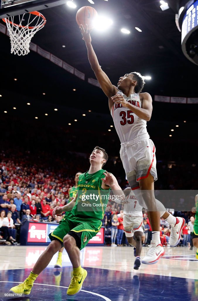 Allonzo Trier #35 of the Arizona Wildcats shoots over Payton Pritchard #3 of the Oregon Ducks during the second half of the college basketball game at McKale Center on January 13, 2018 in Tucson, Arizona. The Wildcats beat the Ducks 90-83.