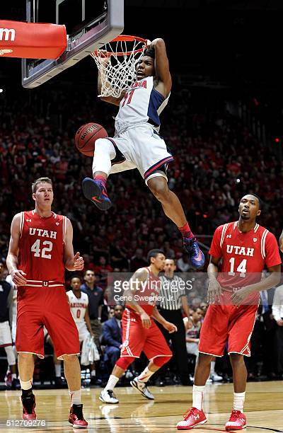 Allonzo Trier of the Arizona Wildcats slams in a basket in front of Jakob Poeltl and Dakarai Tucker of the Utah Utes in the second half of the...