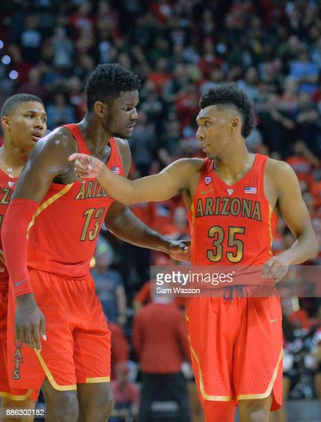 Allonzo Trier of the Arizona Wildcats talks to Deandre Ayton of the Arizona Wildcats during their game against the UNLV Rebels at the Thomas Mack...