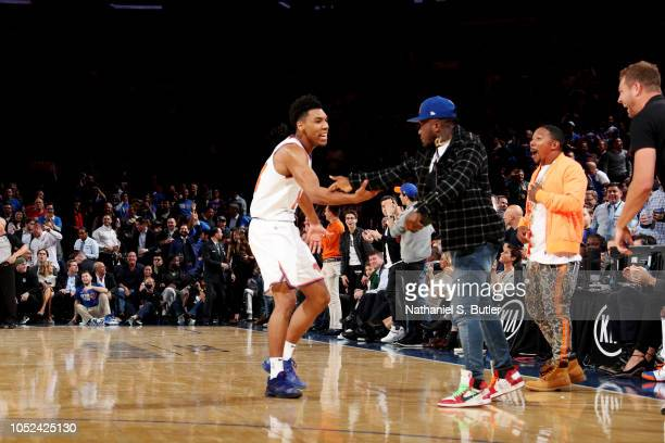Allonzo Trier of the New York Knicks and Nate Robinson exchange a high five during the game against the Atlanta Hawks on October 17 2018 at Madison...