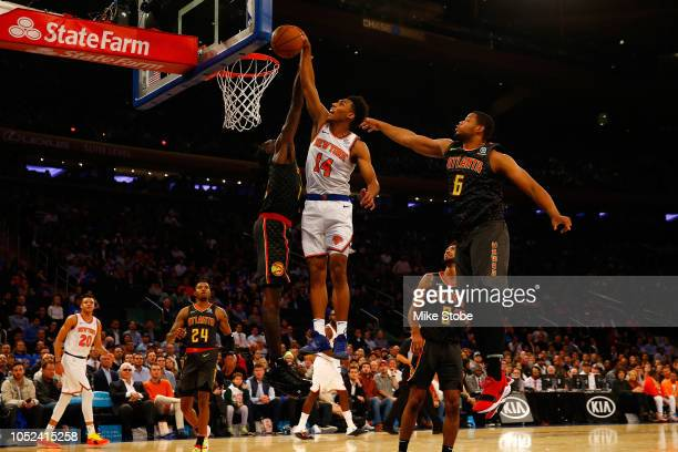 Allonzo Trier of the New York Knicks celebrates dunks the ball against the Atlanta Hawks at Madison Square Garden on October 17 2018 in New York City