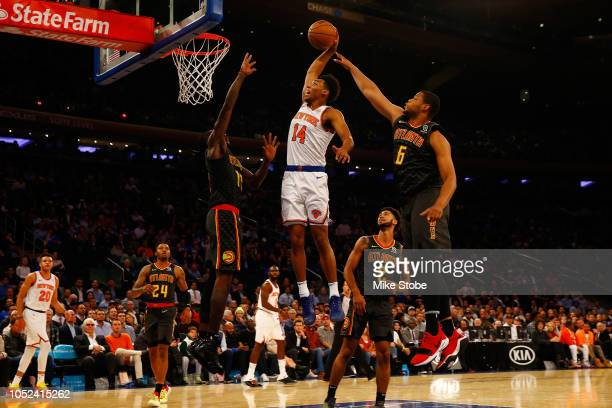 Allonzo Trier of the New York Knicks celebrates dunks the ball against the Atlanta Hawks at Madison Square Garden on October 17, 2018 in New York...
