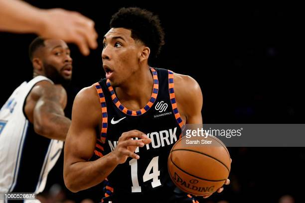 Allonzo Trier of the New York Knicks dribbles past Orlando Magic defense during the game at Madison Square Garden on November 11 2018 in New York...