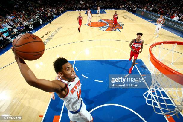 Allonzo Trier of the New York Knicks dunks the ball against the Washington Wizards during a preseason game on October 8 2018 at Madison Square Garden...