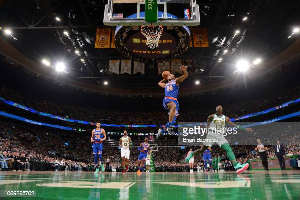 Allonzo Trier of the New York Knicks dunks the ball against the Boston Celtics on December 6 2018 at the TD Garden in Boston Massachusetts NOTE TO...