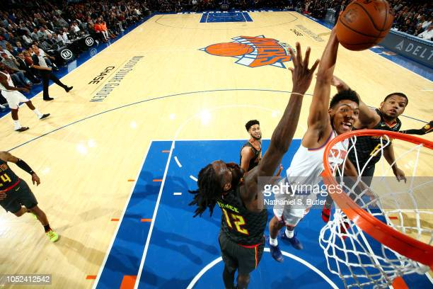 Allonzo Trier of the New York Knicks dunks the ball against the Atlanta Hawks during the game on October 17 2018 at Madison Square Garden in New York...