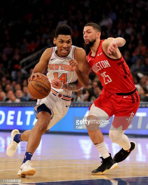 Allonzo Trier of the New York Knicks heads to the net as Austin Rivers of the Houston Rockets defends in the third quarter at Madison Square Garden...