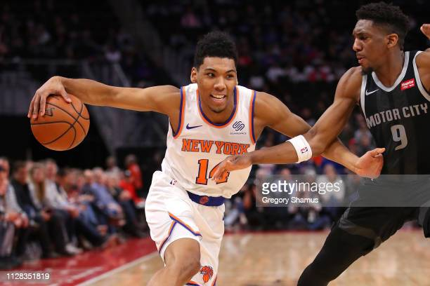 Allonzo Trier of the New York Knicks tries to drive around Langston Galloway of the Detroit Pistons during the first half at Little Caesars Arena on...