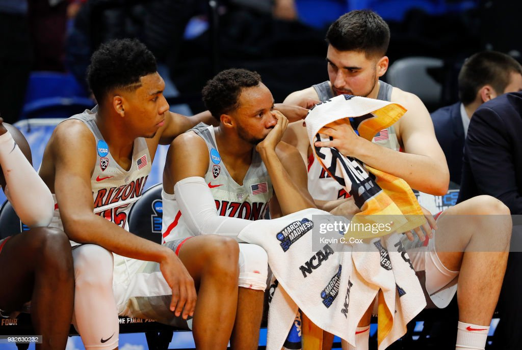 Allonzo Trier #35, Parker Jackson-Cartwright #0, and Dusan Ristic #14 of the Arizona Wildcats react on the bench in the second half against the Buffalo Bulls during the first round of the 2018 NCAA Men's Basketball Tournament at Taco Bell Arena on March 15, 2018 in Boise, Idaho.