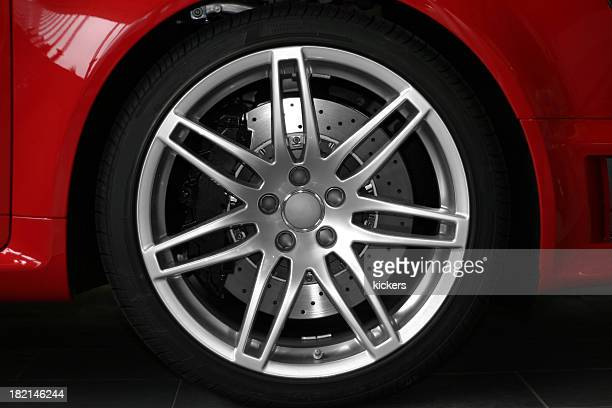 Alloy wheel close up of red sportive car