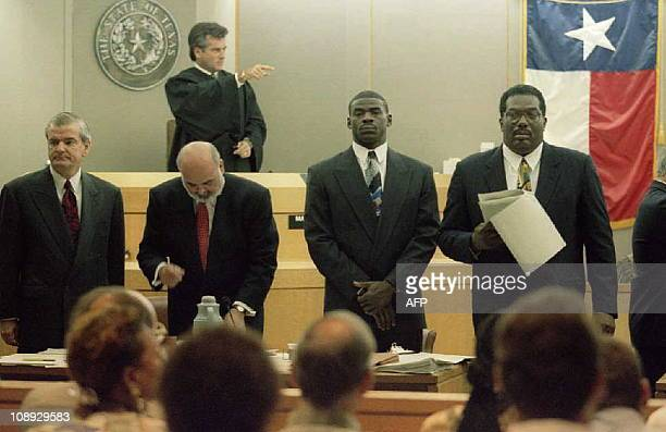 All-Pro wide receiver Michael Irvin of the Dallas Cowboys stands with his attorneys as State District Judge Manny Alvarez speaks to potential jurors...