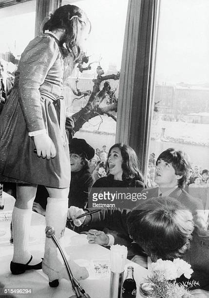 AllStar Cast Salzburg Austria Ringo Starr right foreground_ autographs the plaster cast on the leg of a young Austrian girl during a hotel press...